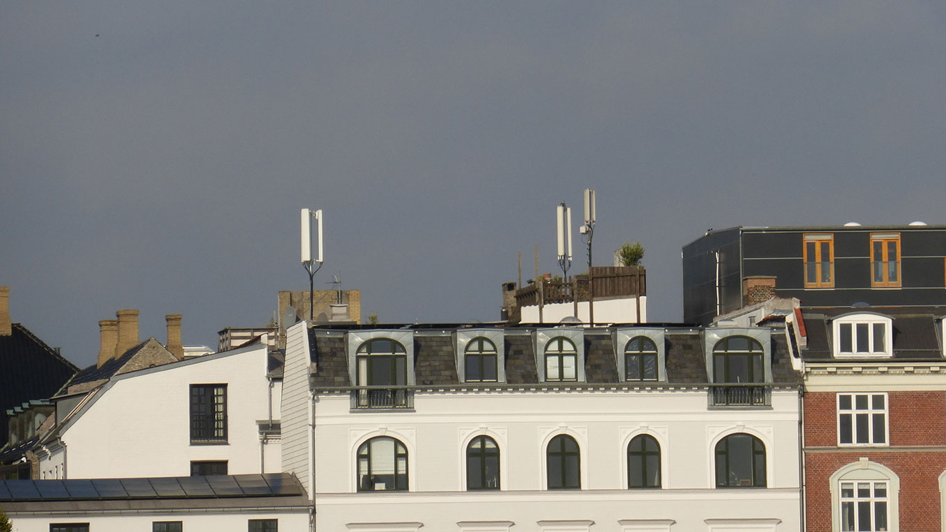 Antennas on top of apartment buildings.