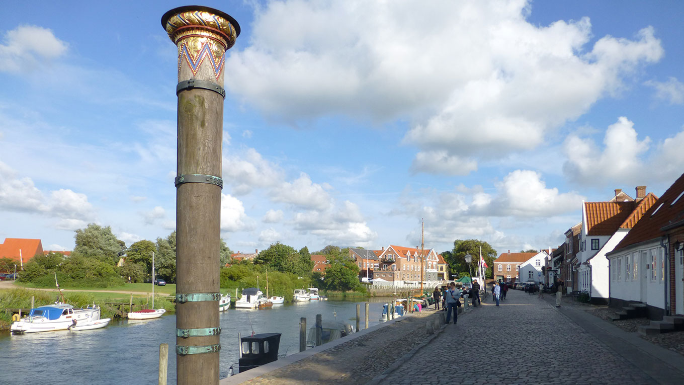 Water levels from storm surges marked on a pillar in a Danish coastal city