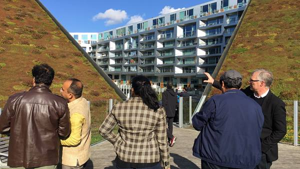 An Indian delegation of architects and city planners from Mumbai visiting Copenhagen, with founder of the Urban Vision think-tank Prathima Manohar in the checkered jacket. Photo from The 8 House.