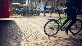Cyclist in street with cobblestones