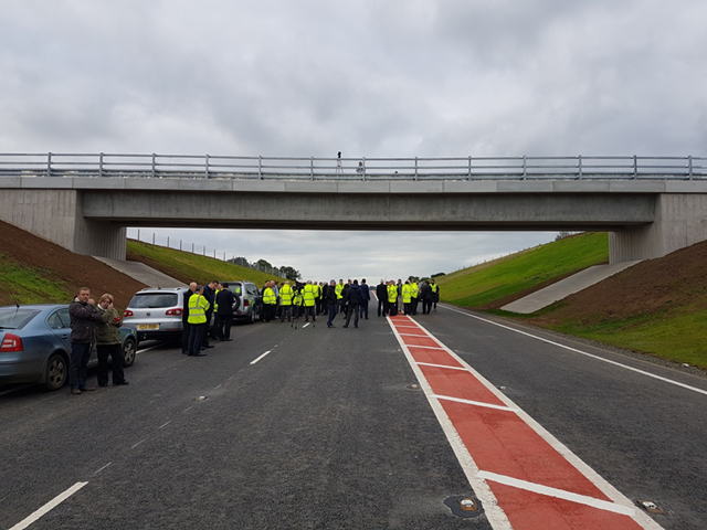 Ramboll. Dignitaries gathered for the road opening on 6 October 2016 close to 'Structure 17 Overbridge' (a farm accommodation overbridge spanning the middle of the cutting that was designed by Ramboll's office in Delhi, working closely with the Southampton Bridges Team).