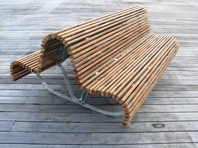Ramboll. Old timber from Hastings Pier was used to make furniture for the restored pier deck