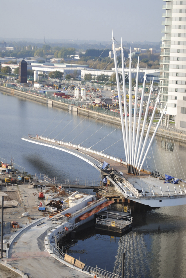 Ramboll. Construction yard on Trafford quayside, showing the bridge in 'open' configuration.