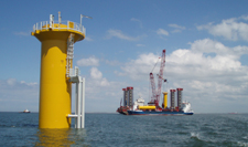 Offshore wind turbine foundation and barge