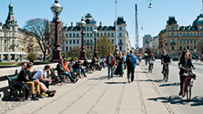 Bridge in Copenhagen with bike lane and people on benches