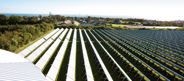 Large scale solar heating facilities lower costs and are significantly more efficient that individual solutions. Click for a detailed view. Image: Morten Larsen