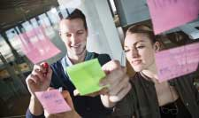 Consultants working and organisational change with post-its