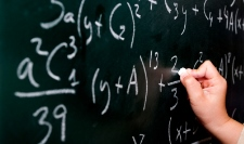 Numbers on blackboard. Cost-benefit analysis