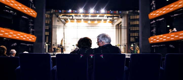 Couple embracing each other in the theatre